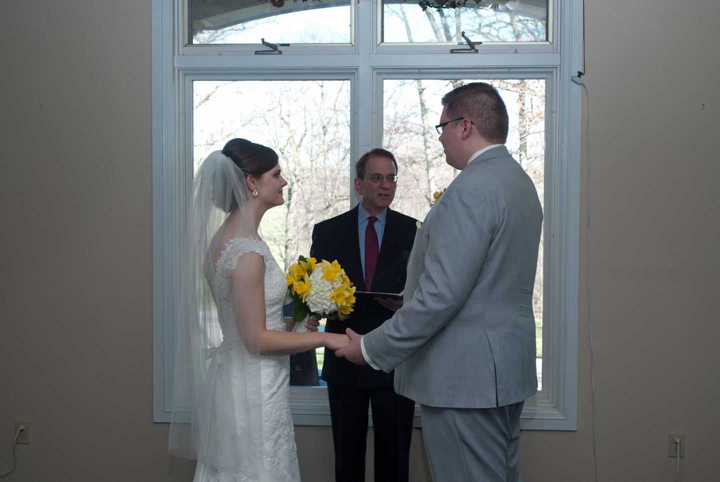 Barry Bradford with the Bride and Groom Officiating the Wedding