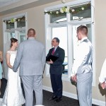 Barry Bradford, wedding officiant, with the Bride and Groom, the Bride's Maids and the Best Men